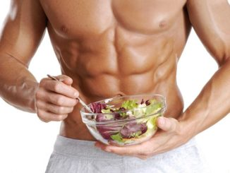 Fitness guy eating salad